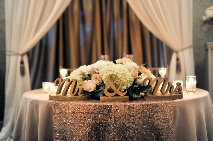 Mr_and_Mrs_blush_and_gold_sweetheart_table__1_.jpg